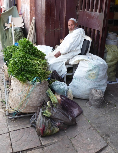 Man selling parsley